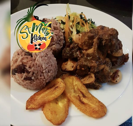 Slow braised Oxtail with Butter Beans served with Rice and Peas, Plantain and steamed veg...